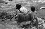 Bolivia, woman and child mining for gold in La Paz
