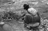 Bolivia, Indian woman mining gold from Tipuani River in La Paz