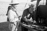 Peru, fishermen preparing meal on truck at Lake Titicaca