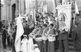 Bolivia, people standing outside church at Lady of Fatima parade in La Paz