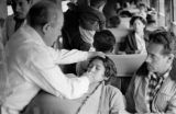 Peru, doctor administering oxygen to passengers on Central Railway (Ferrocarril Central del Perú)