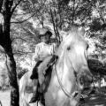 Uruguay, boy on horse at ranch in Paysandú department