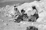Peru, women and children sitting on shore of Lake Titicaca
