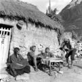 Peru, group sitting near home drinking chicha in Ampe