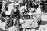 Peru, people eating at Sunday market in Huancayo