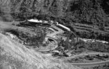 Peru, view of industrial facility and railroad in valley