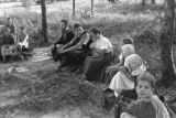 Paraguay, Hutterite community members sitting in open-air school