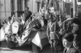Bolivia, men riding float in Lady of Fatima of Caiconi parade in La Paz