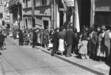 Bolivia, people standing in line on sidewalk in La Paz