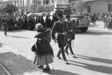 Bolivia, elderly woman passing soldiers in Lady of Fatima parade in La Paz