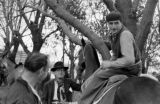 Argentina, man on horse in conversation at Pato game