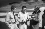 Bolivia, Harrison Forman talking with pilots Garcia and Valdivia