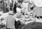 Peru, women selling pottery at Sunday market in Huancayo