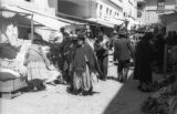 Bolivia, woman in hat and shawl walking through market in La Paz