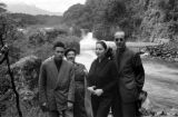 Chile, portrait of family near waterfall