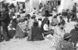 Bolivia, women sitting in group at outdoor market in La Paz