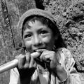Peru, portrait of boy with flute in Pisac