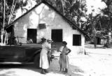 Brazil, Harriet Platt next to car on street in Pará