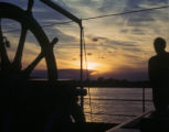 Argentina, people on the boat with sunset