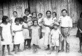 Peru, tagua gatherer and family outside house