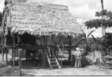 Peru, Harriet Platt and others outside pottery maker's stilt house