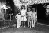 Peru, Pent children pose for picture while Mr. Aish cuts Harriet Platt's hair in Pucallpa