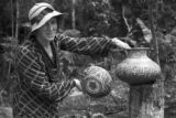 Peru, Harriet Platt displaying pottery