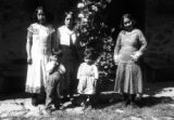 Peru, family posing for picture next to vine