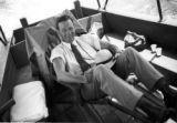 Brazil, Robert S. Platt sitting in chair on boat deck