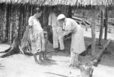 Brazil, Harriet Platt speaking with child outside hut