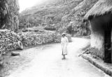 Peru, Harriet Platt walking in dirt road
