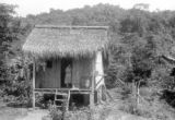 Ecuador, woman in doorway of hut in Bucay