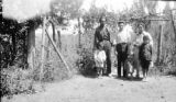 Chile, Lillo Family posing in their front yard at Viña Conchalí