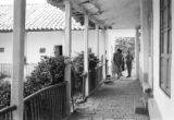 Colombia, people in courtyard of house in Cundinamarca Department