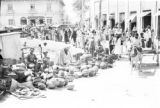 Colombia, vendors selling pottery at market