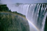 Zambia and Zimbabwe, rainbow over Zambezi River canyon at Victoria Falls