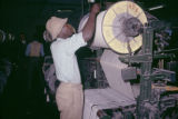 Africa, worker operating machinery at textile mill