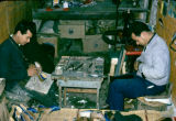 Tunisia, men making shoes in workshop