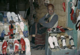 Tunisia, man selling shoes in shop