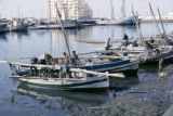 Tunisia, boats docked along waterfront in Sfax