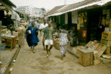 Ghana, people walking through outdoor market