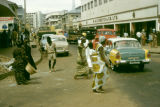 Ghana, street scene with pedestrians crossing Accra commercial street