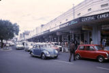 Kenya, car traffic in front of shops in Nairobi