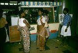 Ghana, people in line for ice cream at stand
