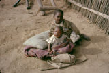 Kenya, young children resting on mat in Kikuyu village
