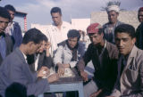 Tunisia, men playing dominoes at outdoor table