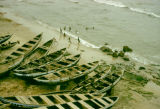 Ghana, boats docked along beach