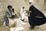 Mali, Tuareg man and tailors on street in Timbuktu