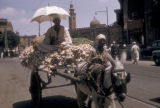 Egypt, donkey-pulled cart with garlic and beans