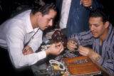 Egypt, men looking at rings in a jewelry store